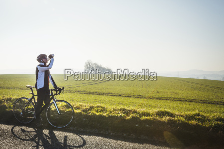 a cyclist by the side of