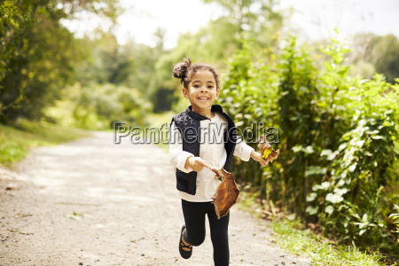 happy little girl running with two