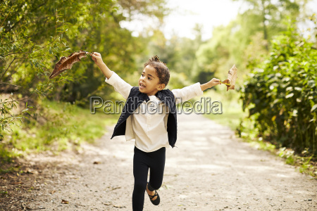 a little girl running with two