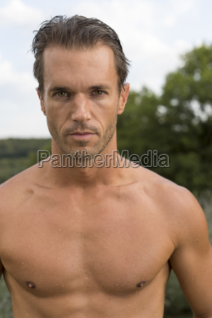 portrait of young shirtless man