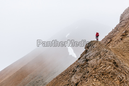 a woman is hiking on a