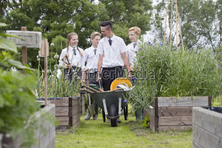 middle school students with wheelbarrow learning