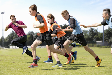 middle schoolboys and teacher running playing