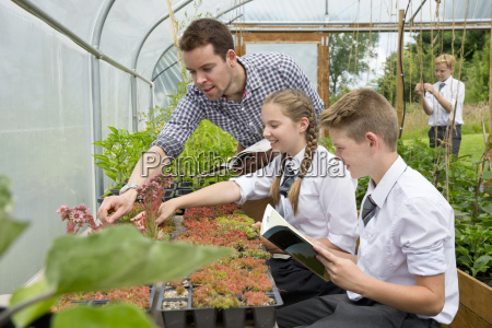 teacher and middle school students learning