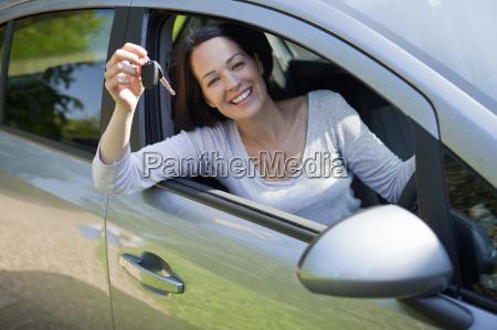 portrait happy woman in new car