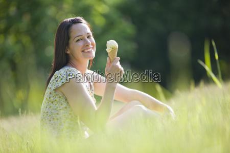 portrait happy woman eating ice cream