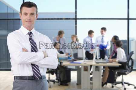 portrait of businessman working in busy