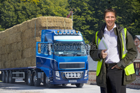 man standing by weighbridge as lorry