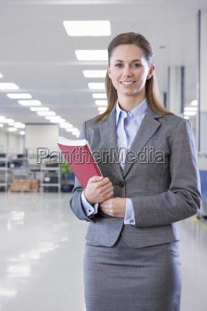 portrait of businesswoman on floor of