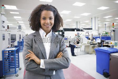portrait of businesswoman on floor of