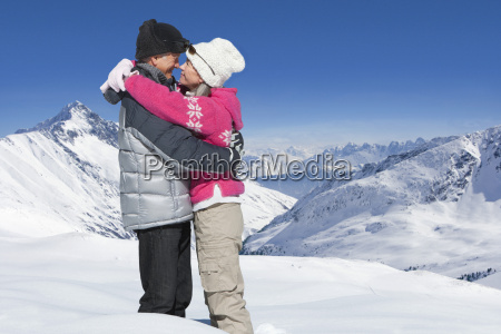 romantic mature couple enjoying winter holiday
