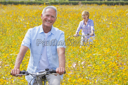 senior couple on cycle ride through