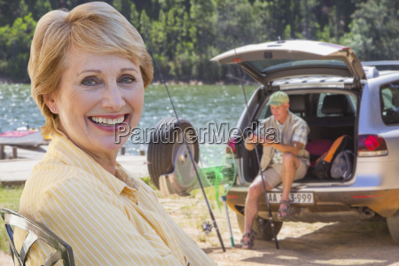 senior couple enjoying fishing trip by