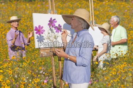 group of seniors enjoying outdoor painting
