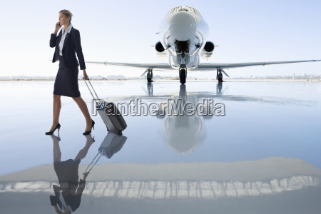 businesswoman using mobile phone by private
