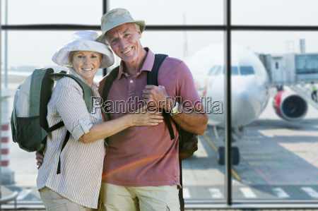 portrait of senior couple in airport