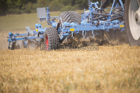 close up of tractor ploughing field