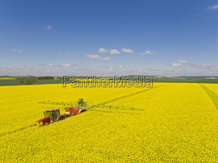 aerial of tractor spraying oilseed rape