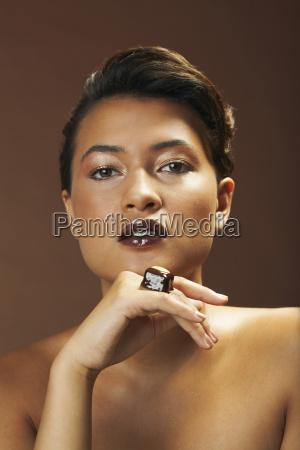 portrait of woman with chocolate ring