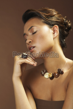 portrait of woman with chocolate jewelry