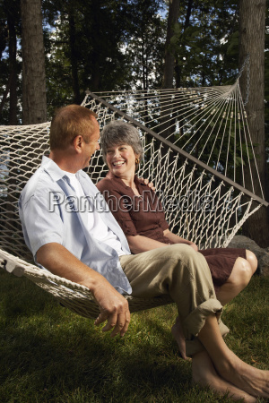 couple sitting on hammock
