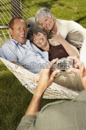 friends in hammock posing for photograph
