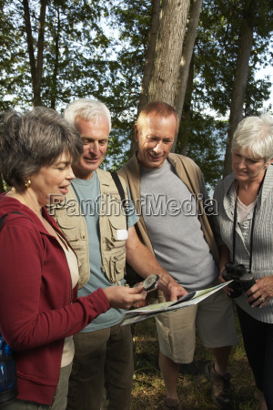 couples in woods with compass and