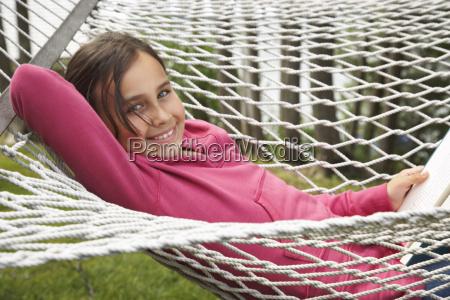 portrait of girl in hammock
