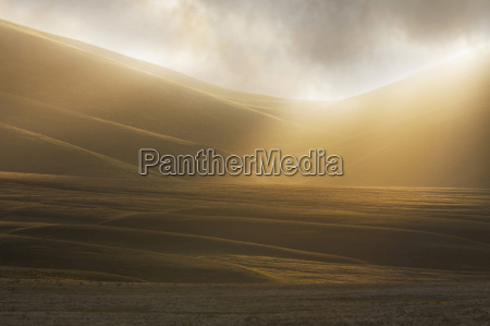 misty sunlight over the fields at