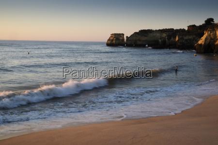 waves hitting beach at lagos algarve
