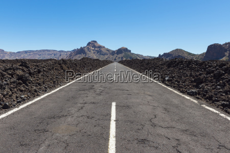 road through lava field in parque