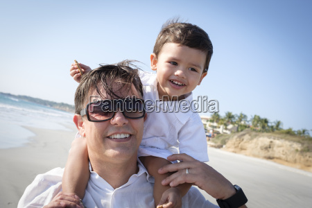 portrait of father carrying his little