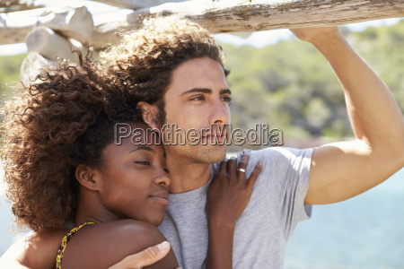 young couple embracing outdoors woman looking
