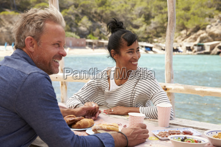 middle aged couple at table by