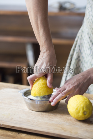 woman squeezing lemon juice