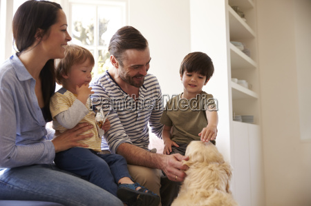 family sitting on window seat at