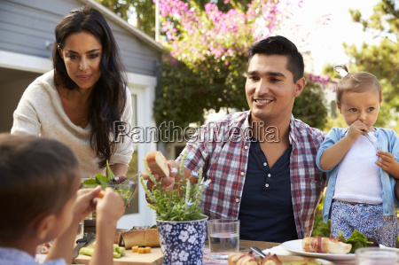family at home eating outdoor meal