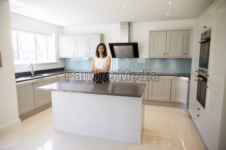 portrait of female realtor in kitchen
