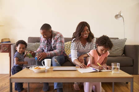 family sitting on sofa as daughter