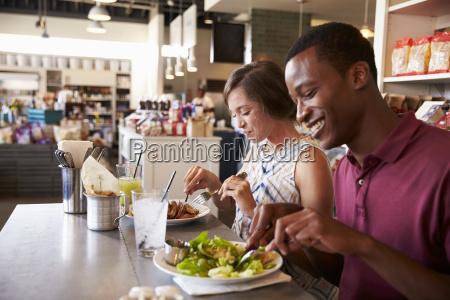 couple enjoying lunch date in delicatessen