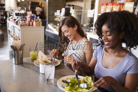 two women enjoying lunch date in