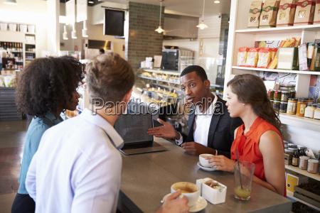 business group having informal meeting in