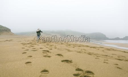 girl running on the beach on
