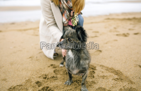 woman with dog looking sideways on