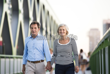 senior couple walking hand in hand