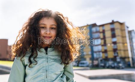 portrait of smiling girl at backlight