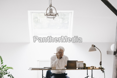 senior businessman working with laptop in