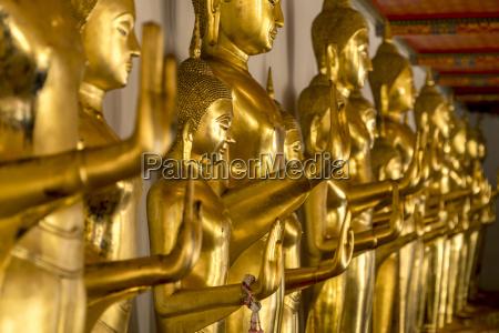 thailand bangkok row of buddha statues