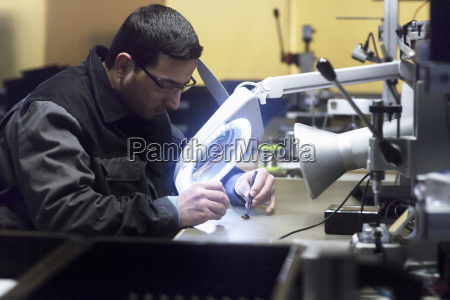 man working in a sensor technology