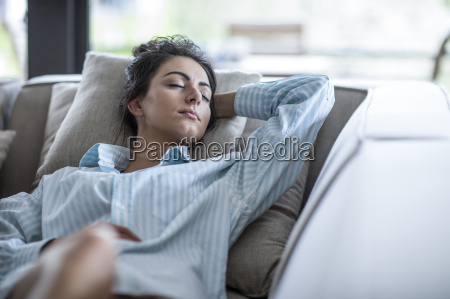young woman relaxing on a couch